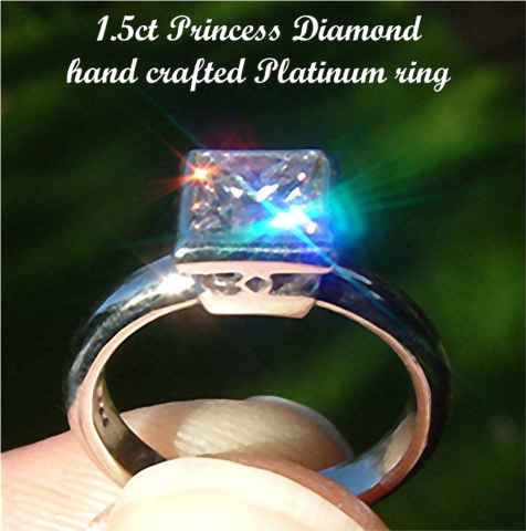 Heavy weight Platinum and fiery Princess Diamond ring