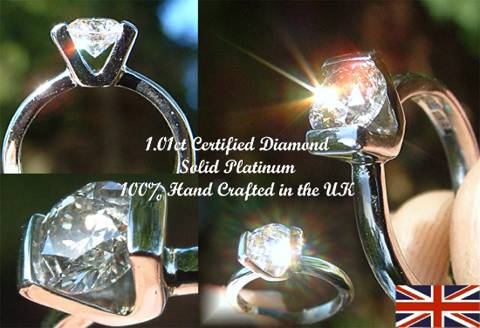 Solid sparkling tension set Diamond in an all Handmade Platinum ring