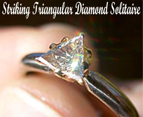Unusual triangular solitaire Diamond in Gold