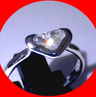 Platinum 1ct shield cut Diamond Solitaire Diamond Ring